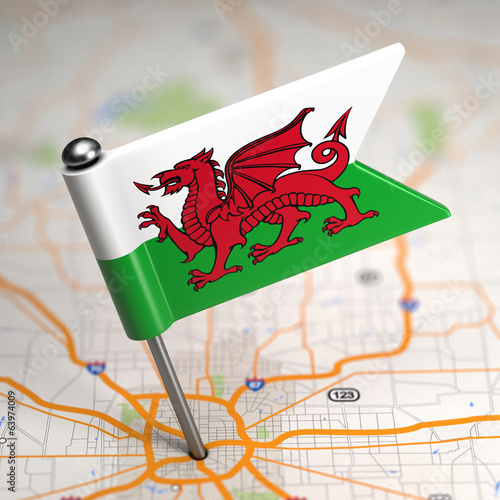 Wales Small Flag on a Map Background.
