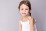 Portrait of relaxing adorable preschooler girl at home