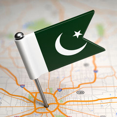 Pakistan - Small Flag on a Map Background.