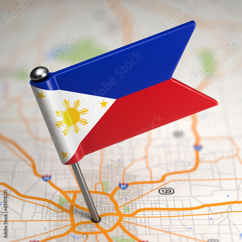 Philippines Small Flag on a Map Background.
