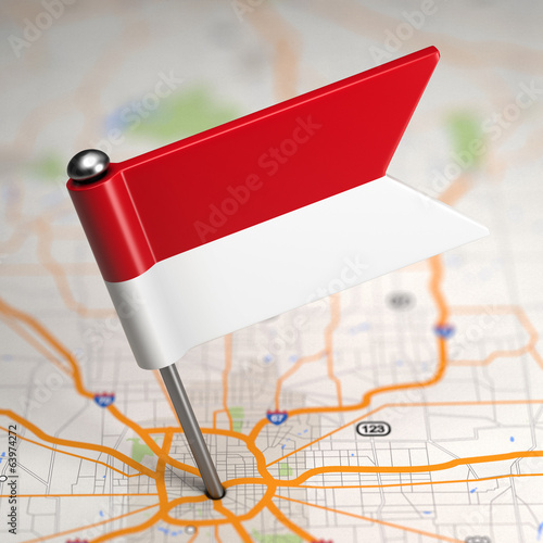 Indonesia Small Flag on a Map Background.