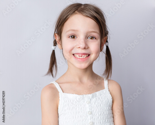 Young preschooler girl with wide smile