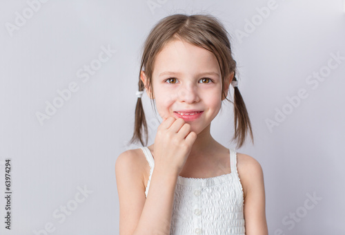 Portrait of pretty preschooler girl at home
