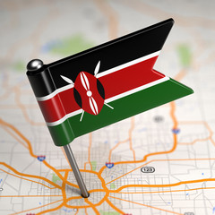 Kenya Small Flag on a Map Background.