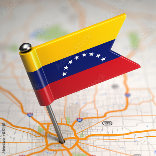 Venezuela Small Flag on a Map Background.