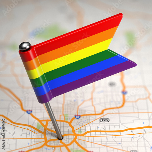 Gay Small Flag on a Map Background.