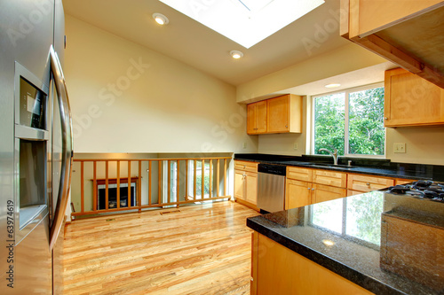 Spacious kitchen room with window in ceiling