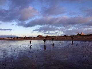 winter beach family