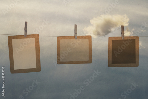 photo frame from old paper on a rope with clothespins