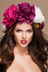 beautiful woman with bright flowers on her head