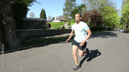 Man running along a road for fitness