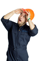 Funny worker in helmet with emotion on her face