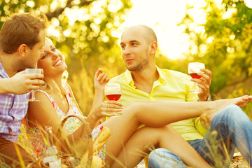 Summer weekend concept. Friends having fun at picnic