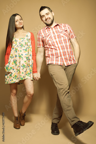 Stylish pregnancy concept: portrait of two happy hipsters