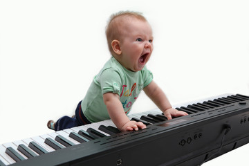 Half-year-old baby playing the piano and singing