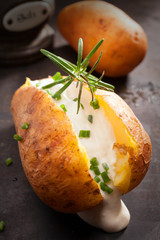 Sliced baked jacket potato with sour cream