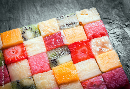 Cubed tropical fruit arranged in a square