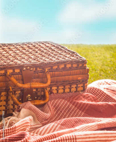 Picnic rug and hamper on a hot summer day