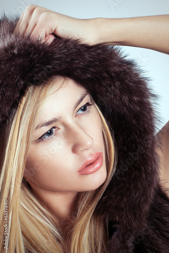 Glamorous blond woman fashion fur style