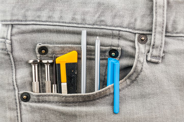 tools in grey jean pocket