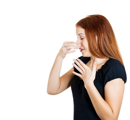 Woman pinches nose very bad smell disgusted face expression