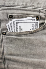 dollars in grey jean pocket