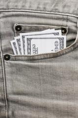 dollars in grey jean pocket