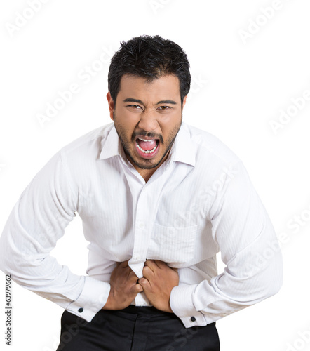 Young man having acute stomach pain