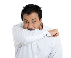 Psychotic man, angry, biting his arm, isolated white background