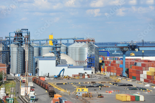 Grain dryer, train and scrap metal in the port