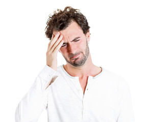 Headache. Young stressed man, student having bad migraine