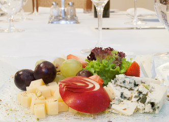 Selection of cheeses with nuts and fruit