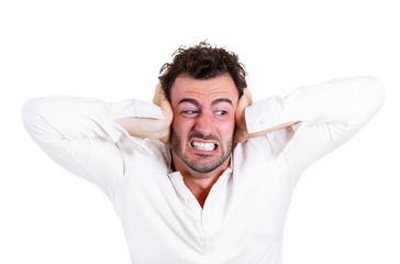 Loud noise, man covers ears asking, stop please