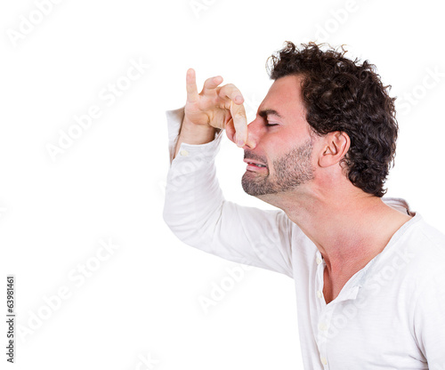 Bad smell. Man pinches his nose very strong odor