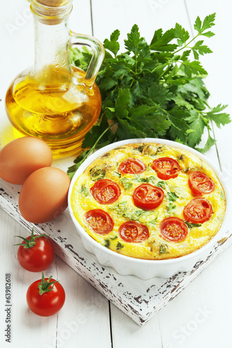 Leinwanddruck Bild Omelet with vegetables and cheese. Frittata