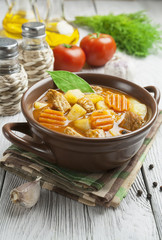 Meat with potatoes and carrots in the bowl
