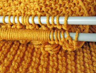 Stitches of Yarn on Knitting Needles