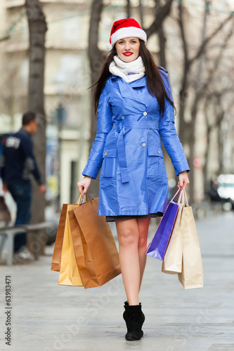 Woman with purchases at street