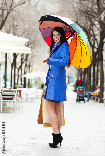 Woman with shopping bags at street