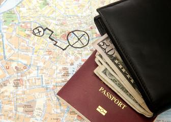 Travel Arrangement of Wallet Dollar notes passport and Map