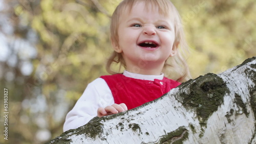 Year-old child on birch