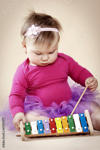 Little toddler with xylophone
