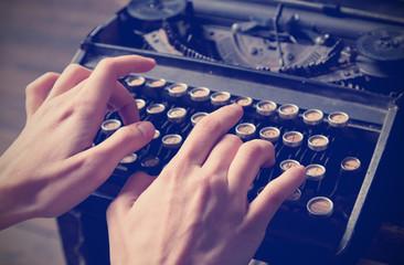 Human hand prints on retro typewriter, instagram effect