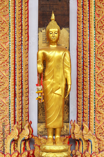 golden buddha statue standing on thai  temple