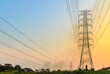 High voltage power lines at sunset. - 63984498