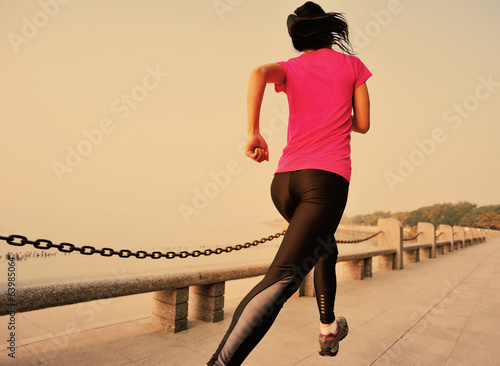healthy lifestyle fitness woman running at seaside