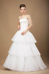 Caucasian Woman in White Long Dress Posing in Studio