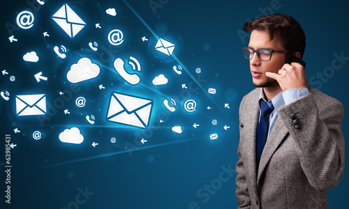 Young man making phone call with message icons