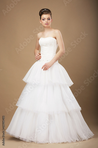 Caucasian Woman in White Long Dress Posing in Studio