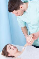 Physiotherapist examining arm